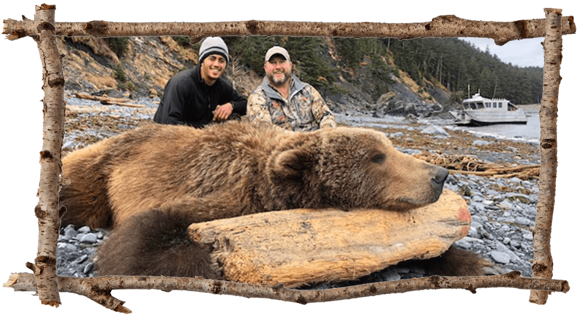2 hunters with brown bear