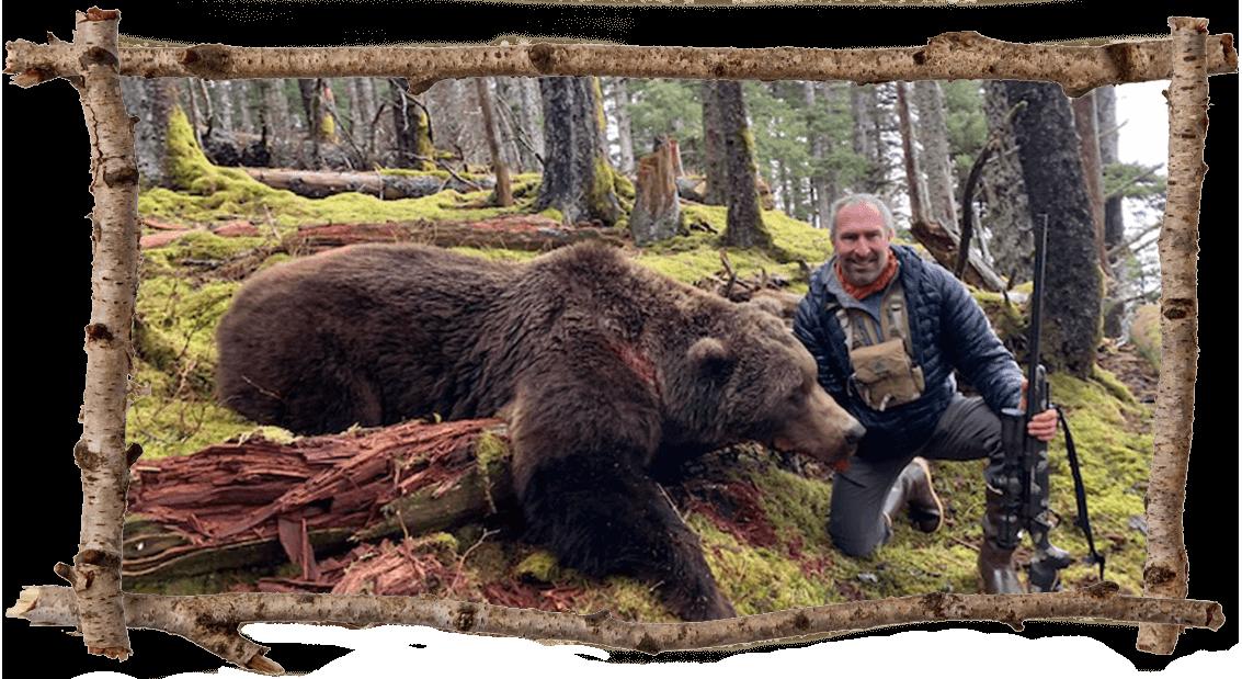 Hunter posing with bear.